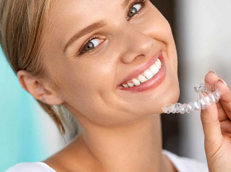 woman happy for her invisalign braces