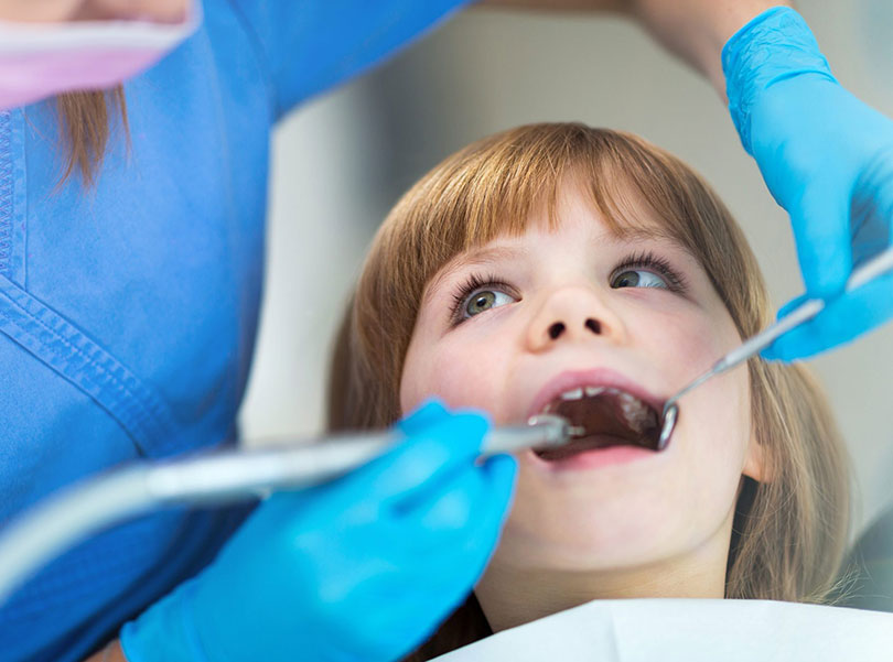 dentist filling kid`s tooth