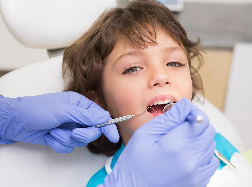 Pediatric dentist visiting a kid