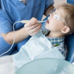 Pediatric and Sedation dentist working on little boy Tysons Corner, Falls Church