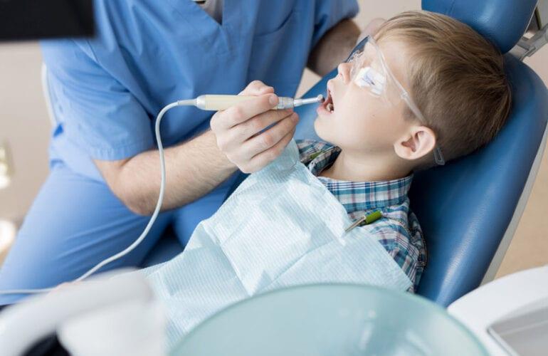 Pediatric and Sedation dentist working on little boy Tysons Corner, Falls Church