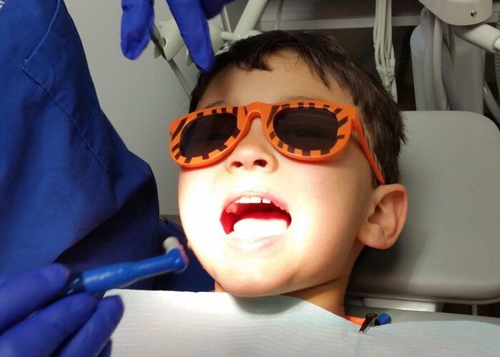 Sedation Dentist working on kid